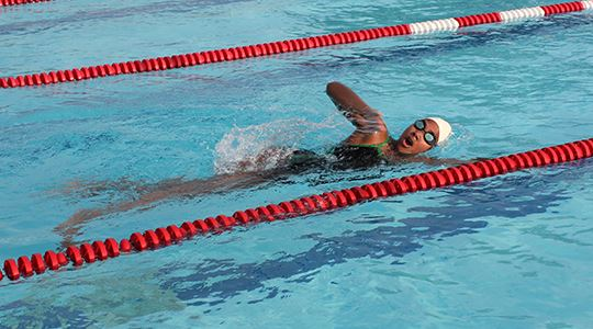 Young girl swimming laps