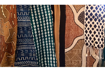 Picture of various styles of mud cloth with different geometric patterns